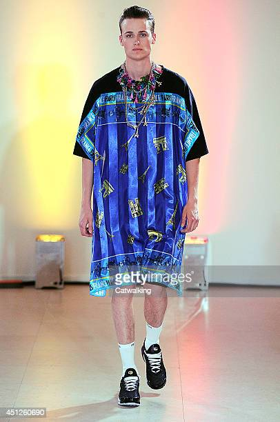 A model walks the runway at the Andrea Crews Spring Summer 2015 fashion show during Paris Menswear Fashion Week on June 26 2014 in Paris France
