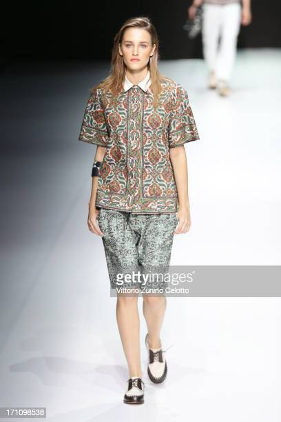 A model walks the runway at the Andrea Pompilio show during Milan Menswear Fashion Week Spring Summer 2014 on June 22 2013 in Milan Italy