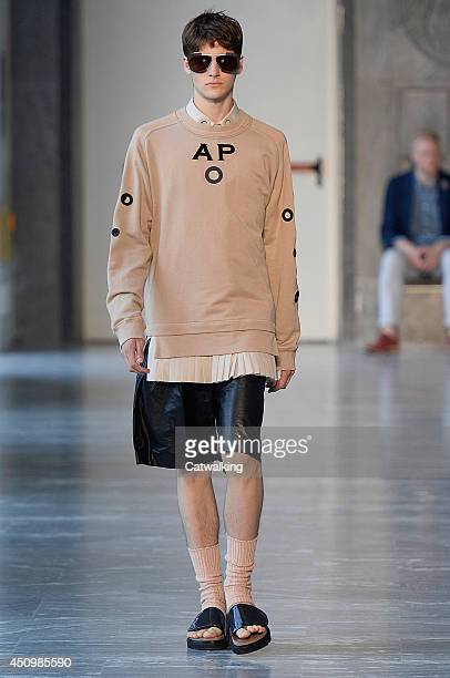 A model walks the runway at the Andrea Pompilio Spring Summer 2015 fashion show during Milan Menswear Fashion Week on June 21 2014 in Milan Italy