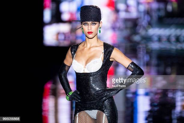 A model walks the runway at the 'Andres Sarda' catwalk during the MercedesBenz Madrid Fashion Week Spring/Summer in Madrid Spain July 09 2018