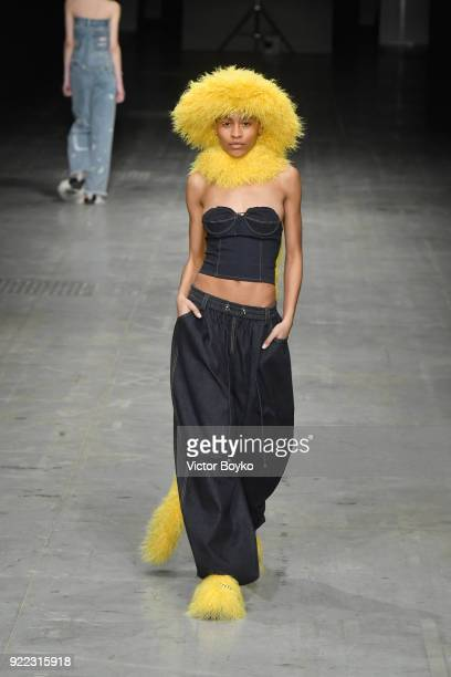 A model walks the runway at the Angel Chen show during Milan Fashion Week Fall/Winter 2018/19 on February 21 2018 in Milan Italy