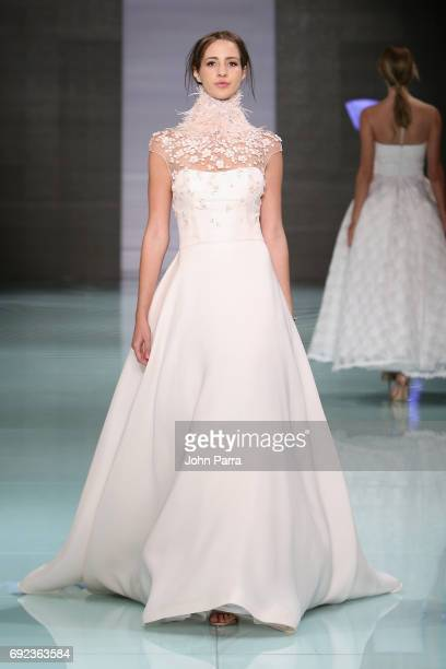 A model walks the runway at the Angel Sanchez Fashion Show at Miami Fashion Week at Ice Palace Film Studios on June 4 2017 in Miami Florida