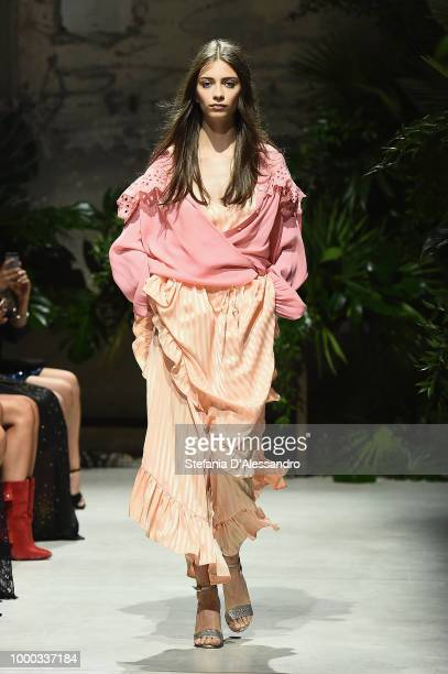 Model walks the runway at the Aniye By Fashion Show SS19 on July 16, 2018 in Milan, Italy.