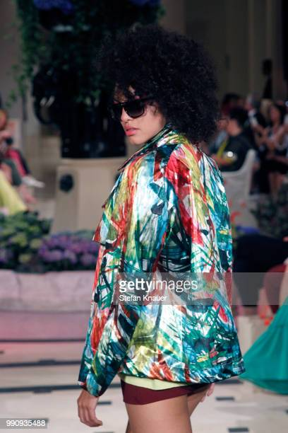 A model walks the runway at the Anja Gockel show during the Berlin Fashion Week Spring/Summer 2019 at Hotel Adlon on July 3 2018 in Berlin Germany