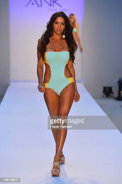 A model walks the runway at the ANK By Mirla Sabino show during MercedesBenz Fashion Week Swim 2013 at The Raleigh on July 23 2012 in Miami Beach...
