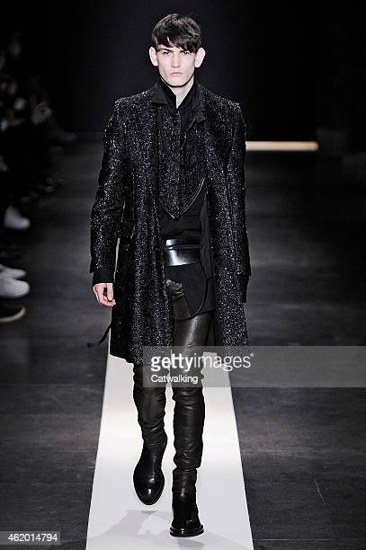 Model walks the runway at the Ann Demeulemeester Autumn Winter 2015 fashion show during Paris Menswear Fashion Week on January 23, 2015 in Paris,...