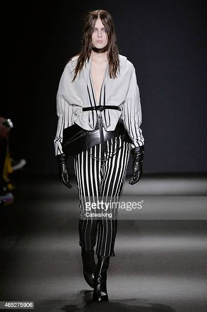 A model walks the runway at the Ann Demeulemeester Autumn Winter 2015 fashion show during Paris Fashion Week on March 5 2015 in Paris France