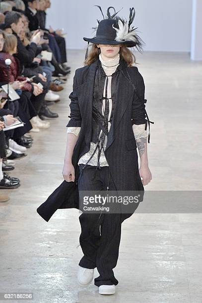 Model walks the runway at the Ann Demeulemeester Autumn Winter 2017 fashion show during Paris Menswear Fashion Week on January 20, 2017 in Paris,...