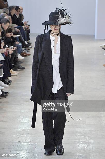 A model walks the runway at the Ann Demeulemeester Autumn Winter 2017 fashion show during Paris Menswear Fashion Week on January 20 2017 in Paris...