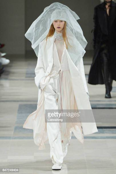 A model walks the runway at the Ann Demeulemeester Autumn Winter 2017 fashion show during Paris Fashion Week on March 2 2017 in Paris France