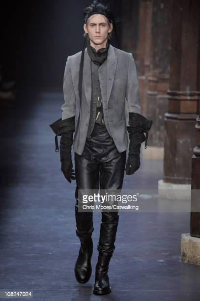 A model walks the runway at the Ann Demeulemeester menswear fashion show during Paris Fashion Menswear Week on January 22 2011 in Paris France