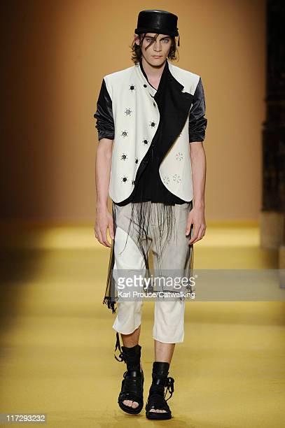 A model walks the runway at the Ann Demeulemeester menswear fashion show during Paris Fashion Menswear Week on June 25 2011 in Paris France