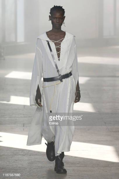 Model walks the runway at the Ann Demeulemeester show during Paris Men's Fashion Week Spring/Summer 2020 on June 21, 2019 in Paris, France.