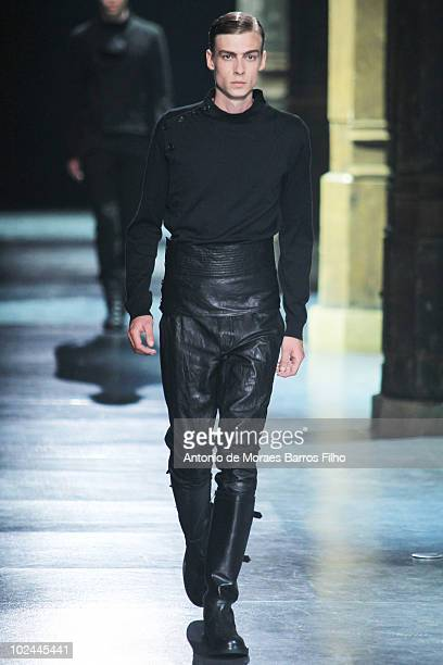 A model walks the runway at the Ann Demeulemeester showas part of Paris Menswear Fashion Week Spring/Summer 2011 at Couvent des Cordeliers on June 26...