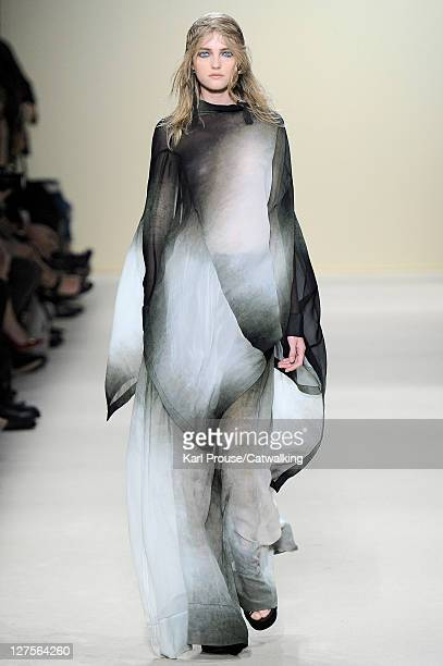 A model walks the runway at the Ann Demeulemeester Spring Summer 2012 fashion show during Paris Fashion Week on September 29 2011 in Paris France