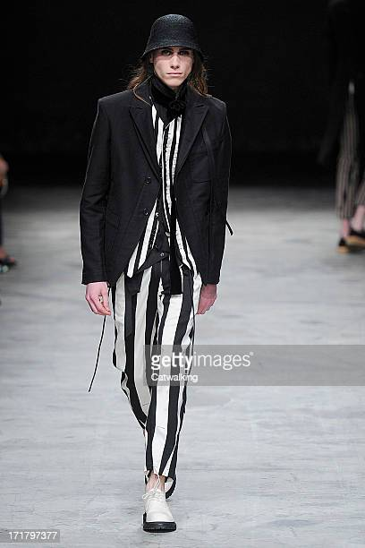 A model walks the runway at the Ann Demeulemeester Spring Summer 2014 fashion show during Paris Menswear Fashion Week on June 28 2013 in Paris France