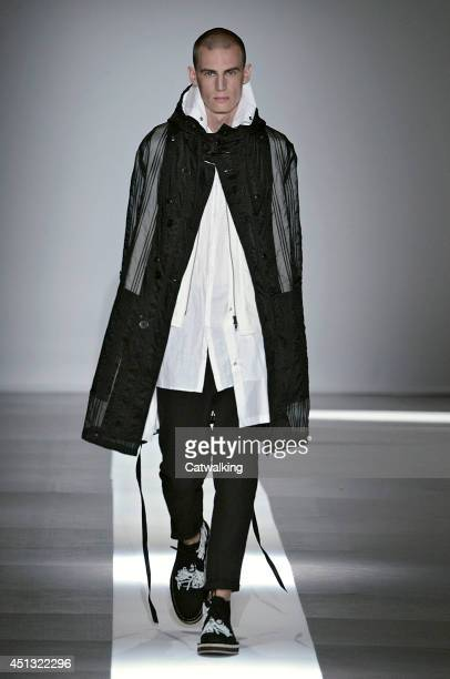 A model walks the runway at the Ann Demeulemeester Spring Summer 2015 fashion show during Paris Menswear Fashion Week on June 27 2014 in Paris France