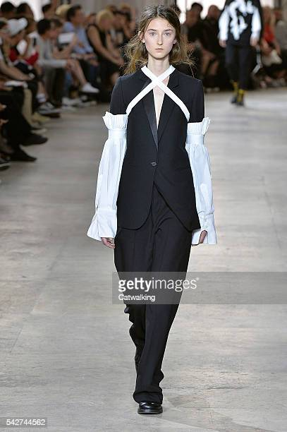 A model walks the runway at the Ann Demeulemeester Spring Summer 2017 fashion show during Paris Menswear Fashion Week on June 24 2016 in Paris France