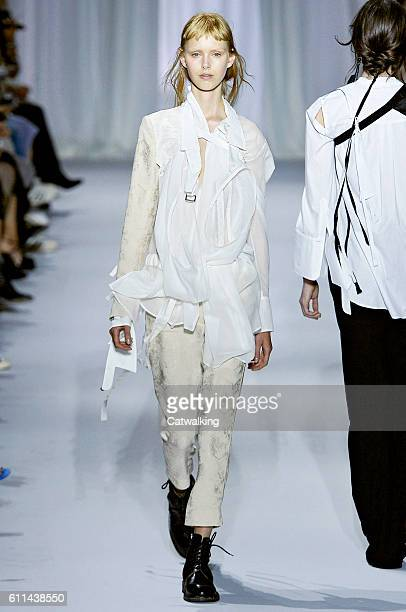 A model walks the runway at the Ann Demeulemeester Spring Summer 2017 fashion show during Paris Fashion Week on September 29 2016 in Paris France