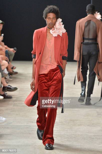 A model walks the runway at the Ann Demeulemeester Spring Summer 2018 fashion show during Paris Menswear Fashion Week on June 23 2017 in Paris France