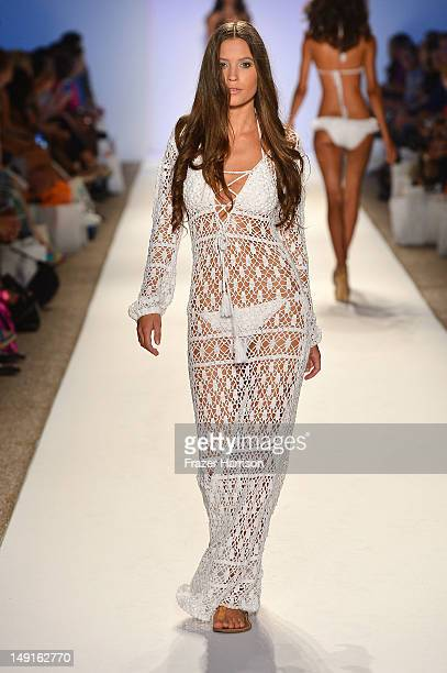 A model walks the runway at the Anna Kosturova show during MercedesBenz Fashion Week Swim 2013 Official Coverage at The Raleigh on July 23 2012 in...
