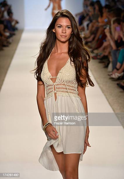 A model walks the runway at the Anna Kosturova show during MercedesBenz Fashion Week Swim 2014 at Cabana Grande at the Raleigh on July 22 2013 in...