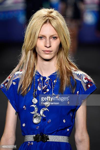 A model walks the runway at the Anna Sui fashion show during MercedesBenz Fashion Week Spring 2015 at The Theatre at Lincoln Center on September 10...
