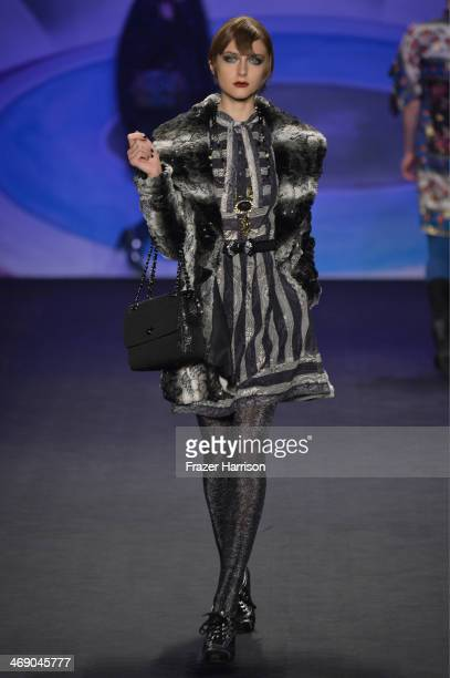 A model walks the runway at the Anna Sui fashion show during MercedesBenz Fashion Week Fall 2014 at The Theatre at Lincoln Center on February 12 2014...
