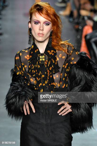 A model walks the runway at the Anna Sui Ready to Wear Fall/Winter 20182019 fashion show during New York Fashion Week on February 12 2018 in New York...