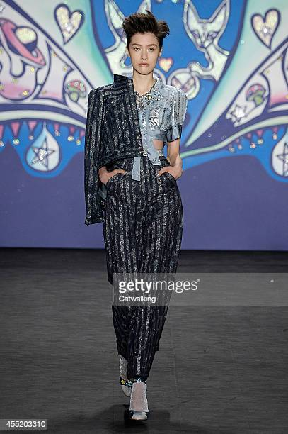A model walks the runway at the Anna Sui Spring Summer 2015 fashion show during New York Fashion Week on September 10 2014 in New York United States