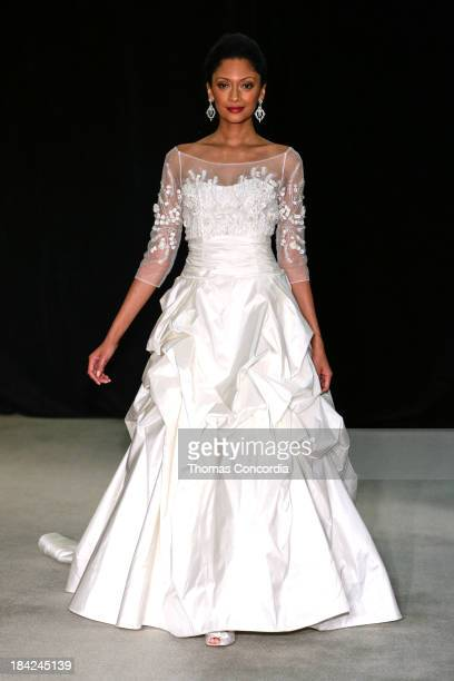 Model walks the runway at the Anne Barge Fall 2014 Bridal collection show at The London Hotel on October 12, 2013 in New York City.