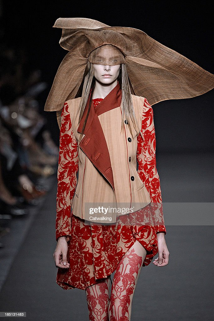A model walks the runway at the Anne Demeulemeester Spring Summer 2014 fashion show during Paris Fashion Week on September 26, 2013 in Paris, France.