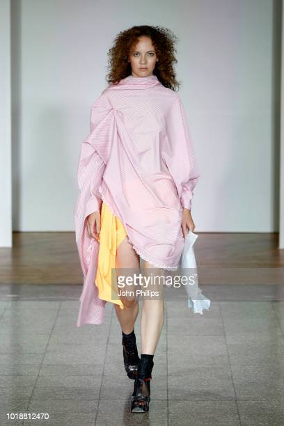 A model walks the runway at the Anne Karine Thorbjornsen show during Oslo Runway SS19 at Bankplassen 4 on August 14 2018 in Oslo Norway