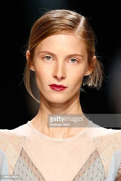 A model walks the runway at the Anne Valerie Hash show during MercedesBenz Fashion Days Zurich 2013 on November 14 2013 in Zurich Switzerland