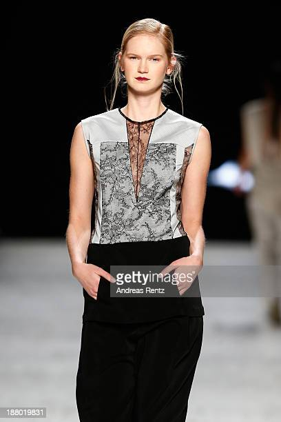 A model walks the runway at the Anne Valerie Hash show during MercedesBenz Fashion Days Zurich 2013 on November 14 2013 in Zurich Switzerland
