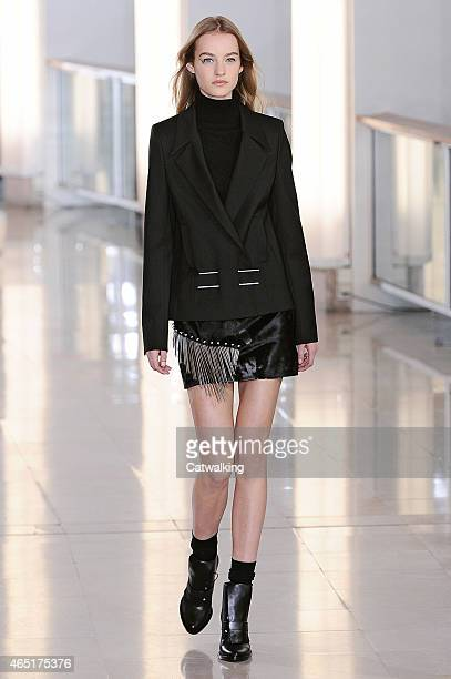 A model walks the runway at the Anthony Vaccarello Autumn Winter 2015 fashion show during Paris Fashion Week on March 3 2015 in Paris France