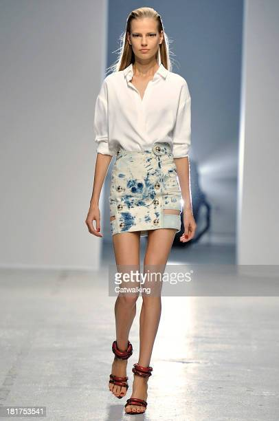 Model walks the runway at the Anthony Vaccarello Spring Summer 2014 fashion show during Paris Fashion Week on September 24, 2013 in Paris, France.