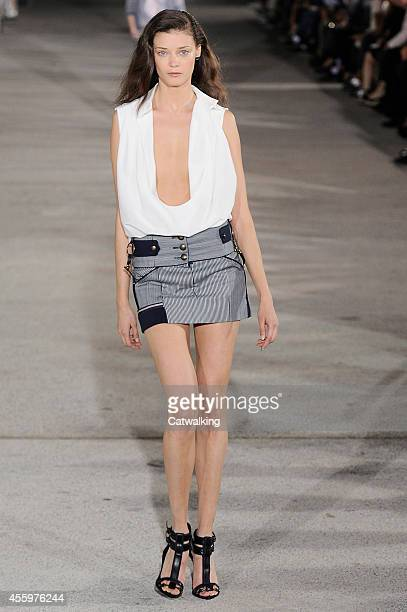 A model walks the runway at the Anthony Vaccarello Spring Summer 2015 fashion show during Paris Fashion Week on September 23 2014 in Paris France