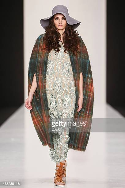 A model walks the runway at the Antonella Rossi show during the MercedesBenz Fashion Week Russia Autumn/Winter 2015/16 at Manege on March 31 2015 in...