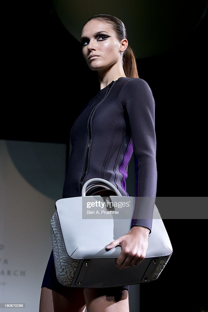 A model walks the runway at the Anya Hindmarch show during London Fashion Week SS14 at on September 17, 2013 in London, England.