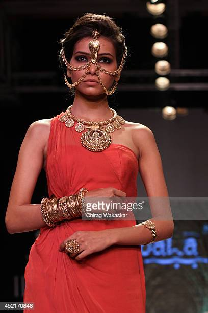 A model walks the runway at the Apala show during day 1 of the India International Jewellery Week 2014 at grand Hyatt on July 14 2014 in Mumbai India