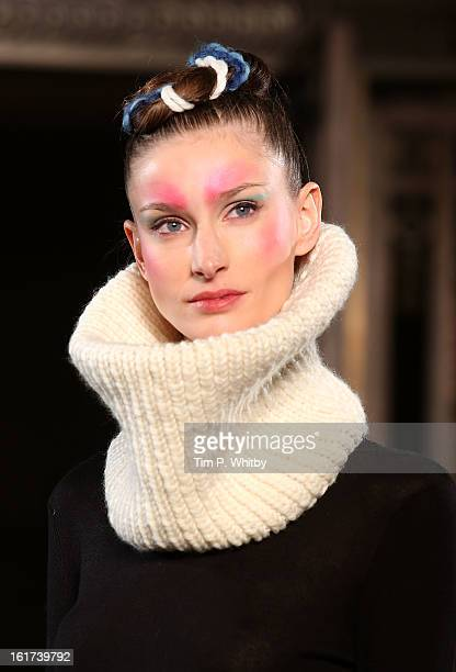 Model walks the runway at the Apu Jan show during London Fashion Week Fall/Winter 2013/14 at Freemasons Hall on February 15 2013 in London England