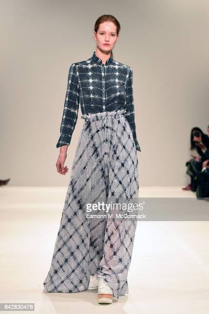 A model walks the runway at the Apu Jan show during the London Fashion Week February 2017 collections on February 19 2017 in London England