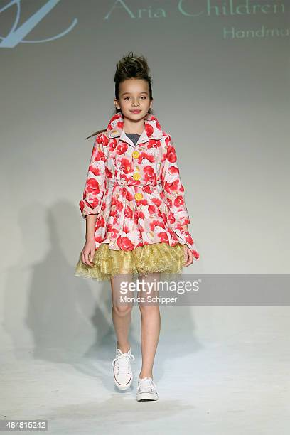 A model walks the runway at the Aria Childrens Clothing show during petitePARADE / Kids Fashion Week at Bathhouse Studios on February 28 2015 in New...