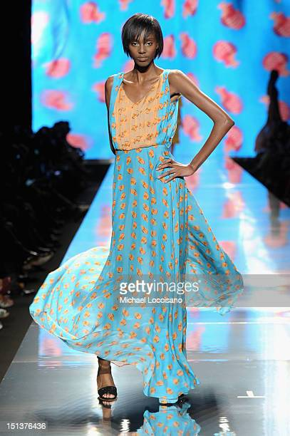A model walks the runway at the Arise Spring 2013 fashion show during MercedesBenz Fashion Week at The Theatre at Lincoln Center on September 6 2012...