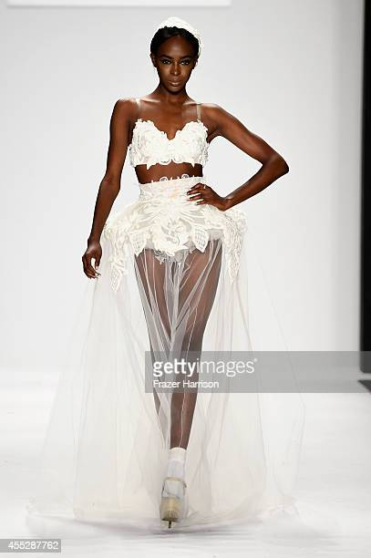 Model walks the runway at the Art Hearts fashion show presented by AIDS Healthcare Foundation during MercedesBenz Fashion Week Spring 2015 at The...