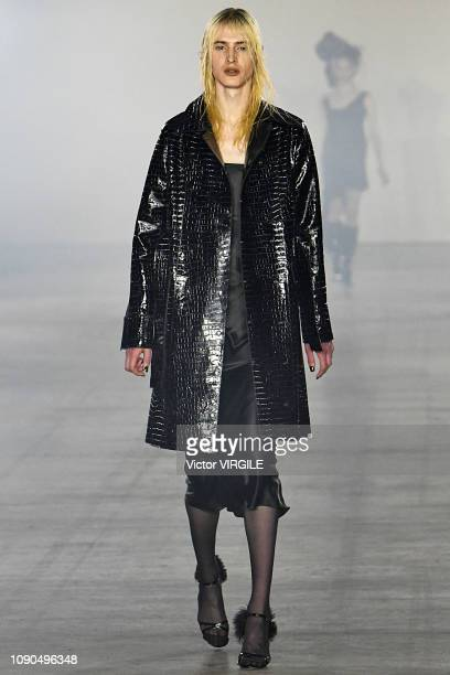Model walks the runway at the Art School Fall/Winter 2019-2020 fashion show during London Fashion Week Men's January 2019 at the BFC Show Space on...