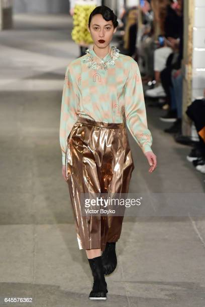 A model walks the runway at the Arthur Arbesser show during Milan Fashion Week Fall/Winter 2017/18 on February 26 2017 in Milan Italy