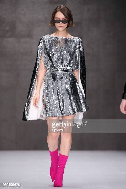 A model walks the runway at the ARUT MSCW fashion show during day one of Mercedes Benz Fashion Week Russia Fall/Winter 2018/19 at Manege at Manege on...