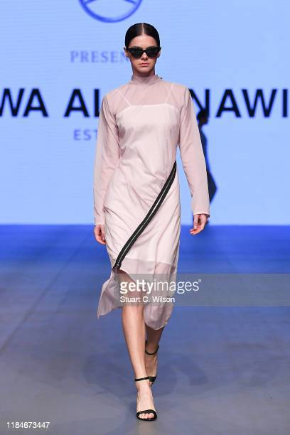 A model walks the runway at the Arwa Al Banawi show during the FFWD October Edition 2019 at the Dubai Design District on October 31 2019 in Dubai...